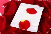 Sanitary pad on rose petals closeup