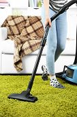 Girl vacuuming in room