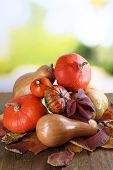Pumpkins on wooden table on natural background