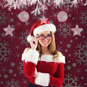 Sexy santa girl wearing spectacles against red vignette