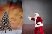 Santa pulls something with a rope against dark room with floorboards