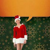 Pretty santa girl smiling at camera against green vignette