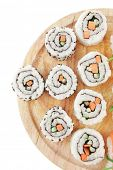 Japanese traditional Cuisine - Maki Roll with Cucumber , Cream Cheese and Raw Salmon inside served with Nigiri topped raw Salmon Tuna and Eel . Isolated over white background