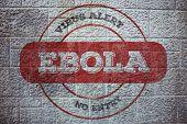 Ebola virus alert stamp against grey brick wall