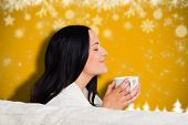 Woman enjoying a lovely drink against blurred fir tree background