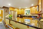 Maple Kitchen Cabinet With Black Granite Tops
