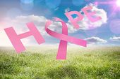 Breast cancer awareness message of hope against sunny landscape