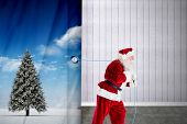 Santa claus pulling rope against grey room