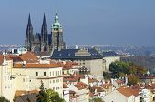 typical urban landscape in the city of Prague, out among the buildings of St. Vitus Cathedral, Czech Republic.