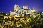 Segovia, Spain town skyline with the Alcazar at night.