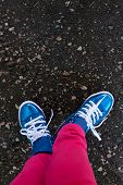 sneakers closeup stand on road