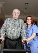 Senior With Smiling Nurse