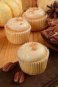 stock photo of pecan  - Gourmet pecan pie or caramel apple cupcakes with fresh pecans - JPG
