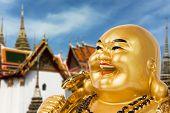 Golden Buddha souvenir over China house