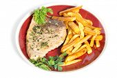 foto of swordfish  - Swordfish steak cooked on a plate with french fries and a parsley and garlic butter sauce - JPG