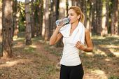 Beautiful Young Women Drinking Water After Running