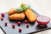 Fried Cheese Sticks Served With Cranberries, Sauce On Black Stone