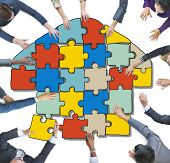 Group of People Forming Home by Jigsaw in Photo Illustration