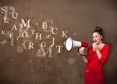Young girl shouting into megaphone and abstract text come out