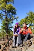 foto of canary  - Hikers couple relaxing eating lunch sandwich - JPG