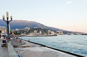 Tourists On Waterfront In Yalta City In Evening