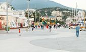 People On Promenade In Yalta City In Evening
