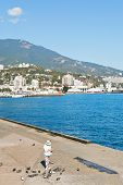 People On Waterfront Of Yalta City In Crimea