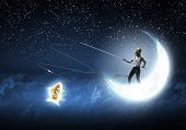 Cute girl standing on moon with fishing rod