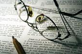 Pencil & Glasses   Over Opend Book