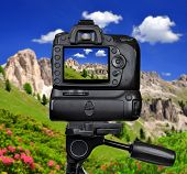Dslr camera photographing mountain landscape