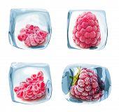 Ice cube frozen raspberry isolated on white background.