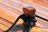 Mooring Node Closeup On Wooden Deck Of A Yacht