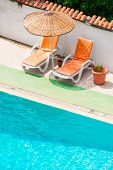 Sun Loungers And Parasols Near The Pool