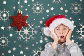 Festive surprised boy against snowflake wallpaper pattern