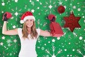 Festive blonde with boxing gloves and shopping bag against snowflake wallpaper pattern
