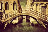 Venice, Italy vintage canvas. A romantic bridge over a narrow canal among old Venetian architecture. Retro style