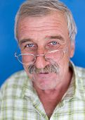 Confident elderly good looking man
