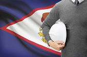 picture of samoa  - Engineer with flag on background  - JPG