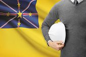 Engineer With Flag On Background - Niue