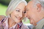 Closeup of loving senior couple looking at each other at nursing home