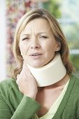 Woman Wearing Surgical Collar In Pain