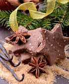 Chocolate homemade Christmas cookies in the shape of stars with sesame seeds