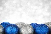 Chritmas balls on glitters with bokeh background