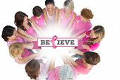 Cheerful women joined in a circle wearing pink for breast cancer against breast cancer awareness message