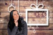 Smiling woman looking to distance against blurred christmas background