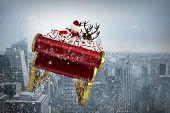 Santa flying his sleigh against cityscape