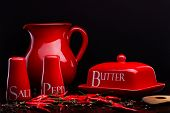 stock photo of pepper  - Closup of red gloss ceramic salt - JPG