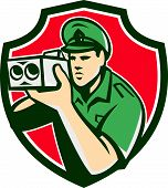 pic of policeman  - Illustration of a policeman police officer holding speed camera set inside shield crest done in retro style on isolated background - JPG