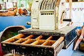 picture of cash register  - Vintage cash register with money drawer open surrounded with bunch of antiques. ** Note: Visible grain at 100%, best at smaller sizes - JPG