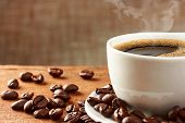 stock photo of tables  - Coffee cup and coffee beans on table - JPG